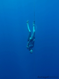 Dominique working on her freefall into Romblon's deep blue.